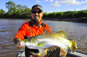 Garry Rayner with his first Barramundi, caught in Hervey Bay